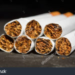 stock-photo-close-up-tobacco-cigarettes-marco-detail-451660288